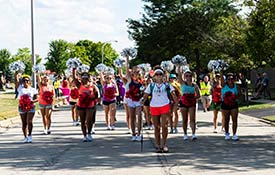 The neighborhoods around Palatine High School rang with the sounds of music as the PHS Marching Band